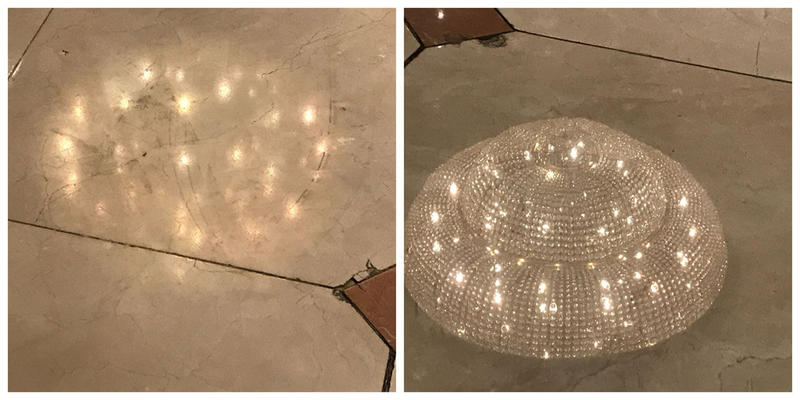 Marble floor reflecting chandelier before and after Orbot restoration