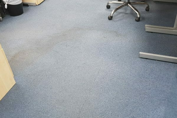 Water stained office carpet tiles